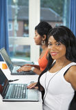 Pretty students on laptops Stock Photo