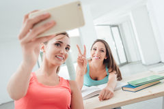 Pretty students taking self portraits Royalty Free Stock Photography