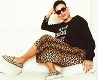 Pretty stylish african american big mama woman well dressed. swag relax at home, leopard print on clothers. Fashion look royalty free stock image