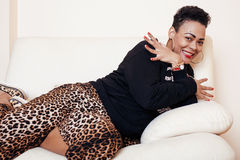 Pretty stylish african american big mama woman well dressed. swag relax at home, leopard print on clothers. fashion look Stock Photo