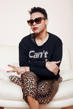 Pretty stylish african american big mama woman well dressed. swag relax at home, leopard print on clothers. fashion look. Sunglasses royalty free stock image