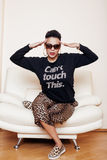 Pretty stylish african american big mama woman well dressed. swag relax at home, leopard print on clothers. fashion. Look sunglasses royalty free stock images