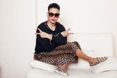 Pretty stylish african american big mama woman well dressed. swag relax at home, leopard print on clothers. fashion Royalty Free Stock Photography