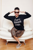 Pretty stylish african american big mama woman well dressed. swag relax at home, leopard print on clothers. fashion. Look sunglasses stock photography