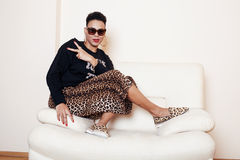 Pretty stylish african american big mama woman well dressed. swag relax at home, leopard print on clothers. fashion. Look sunglasses royalty free stock photos