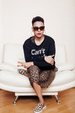 Pretty stylish african american big mama woman well dressed. swag relax at home, leopard print on clothers. fashion. Look sunglasses stock photo