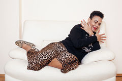 Pretty stylish african american big mama woman well dressed. swag relax at home, leopard print on clothers. fashion. Look sunglasses stock images