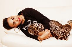 Pretty stylish african american big mama woman well dressed. swag relax at home, leopard print on clothers Stock Photos