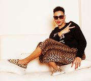 Pretty stylish african american big mama woman well dressed. swag relax at home, leopard print on clothers Royalty Free Stock Image