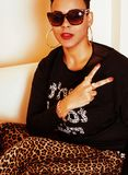 Pretty stylish african american big mama woman well dressed. swag relax at home, leopard print on clothers. Fashion look stock photography
