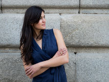 Pretty and stylish dark hair woman. Wearing a navy blue dress royalty free stock photography