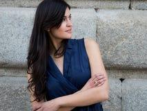 Pretty and stylish dark hair woman. Wearing a navy blue dress stock photo