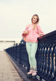 Pretty stylish smiling roller girl outdoors Royalty Free Stock Images