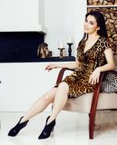 Pretty stylish woman in fashion dress with leopard print in luxury house interior, lifestyle people concept. Closeup stock photo