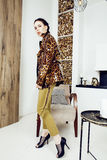 Pretty stylish woman in fashion dress with leopard print together in luxury rich room interior, lifestyle people concept Royalty Free Stock Images