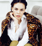 Pretty stylish woman in fashion dress with leopard print together in luxury rich room interior, lifestyle people concept. Modern brunette together close up Stock Photos