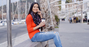 Pretty stylish young woman in colorful fashion Stock Photo