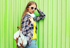 Pretty stylish young woman in trendy style over green Stock Photo