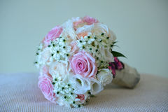 Pretty summer wedding bouquet with different colors roses. Horizontal shot of a round summer bridal bouquet with different colors and varieties of roses and Stock Photos