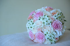 Pretty summer wedding bouquet with different colors roses. Horizontal shot of a round summer bridal bouquet with different colors and varieties of roses and stock image