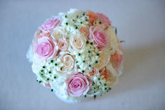 Pretty summer wedding bouquet with different colors roses. Shot from above of a round summer bridal bouquet with different colors and varieties of roses and royalty free stock image