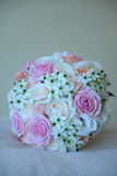 Pretty summer wedding bouquet with different colors roses. Vertical shot of a round summer bridal bouquet with different colors and varieties of roses and garden Stock Photography