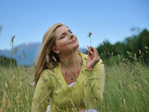 Pretty summer woman outdoors on green field Royalty Free Stock Photo