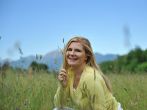 Pretty summer woman outdoors on green field Royalty Free Stock Images