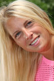 Pretty sun-tanned blond girl in natural light Royalty Free Stock Images