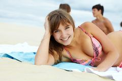 Pretty sunbather. Portrait of pretty girl in bikini lying on the beach and sunbathing Royalty Free Stock Photo