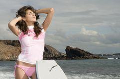 Pretty surfer girl waiting for waves Royalty Free Stock Images
