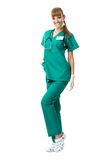 Pretty surgeon woman in a green dress Stock Photos