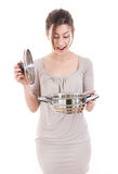 Pretty surprised woman opening a pot Royalty Free Stock Photos