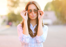 Pretty sweet girl in sunglasses Stock Images