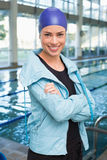 Pretty swimmer smiling at camera by the pool Stock Images