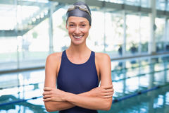 Pretty swimmer smiling at camera by the pool Royalty Free Stock Images