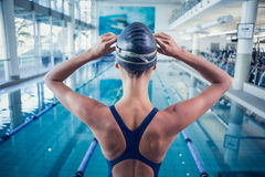 Pretty swimmer standing by the pool Royalty Free Stock Image
