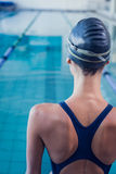 Pretty swimmer standing by the pool Stock Image