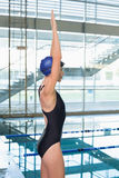 Pretty swimmer stretching arms by the pool Stock Photos