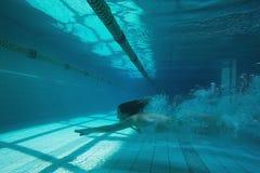 Pretty swimmer swimming underwater in bikini Stock Photos