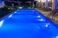 Pretty swimming pool in night at a local resort Royalty Free Stock Image