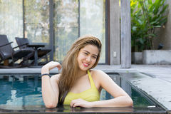 Pretty swimsuit fashion young sexy asian woman posing in pool Royalty Free Stock Photos