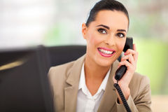 Switchboard operator telephone. Pretty switchboard operator answering telephone Royalty Free Stock Images