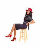 Pretty tall black woman sitting. Royalty Free Stock Image