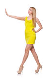 Pretty tall woman in short yellow dress isolated Royalty Free Stock Images