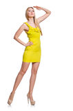 Pretty tall woman in short yellow dress isolated Royalty Free Stock Photos