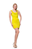 Pretty tall woman in short yellow dress isolated. The pretty tall woman in short yellow dress isolated on white Royalty Free Stock Photography