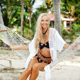 Pretty tanned young woman relaxing on a beach Royalty Free Stock Images