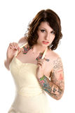 Pretty tattoo girl in dress Stock Images
