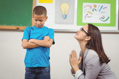 Pretty teacher begging pupil for something Royalty Free Stock Image
